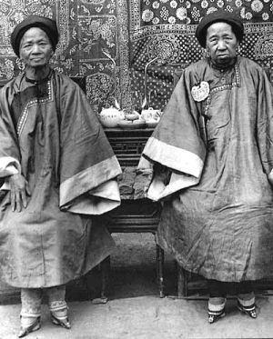 Two Chinese women with (concealed) bound feet